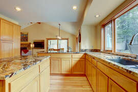 The kitchen is large, roomy and very well equipped.