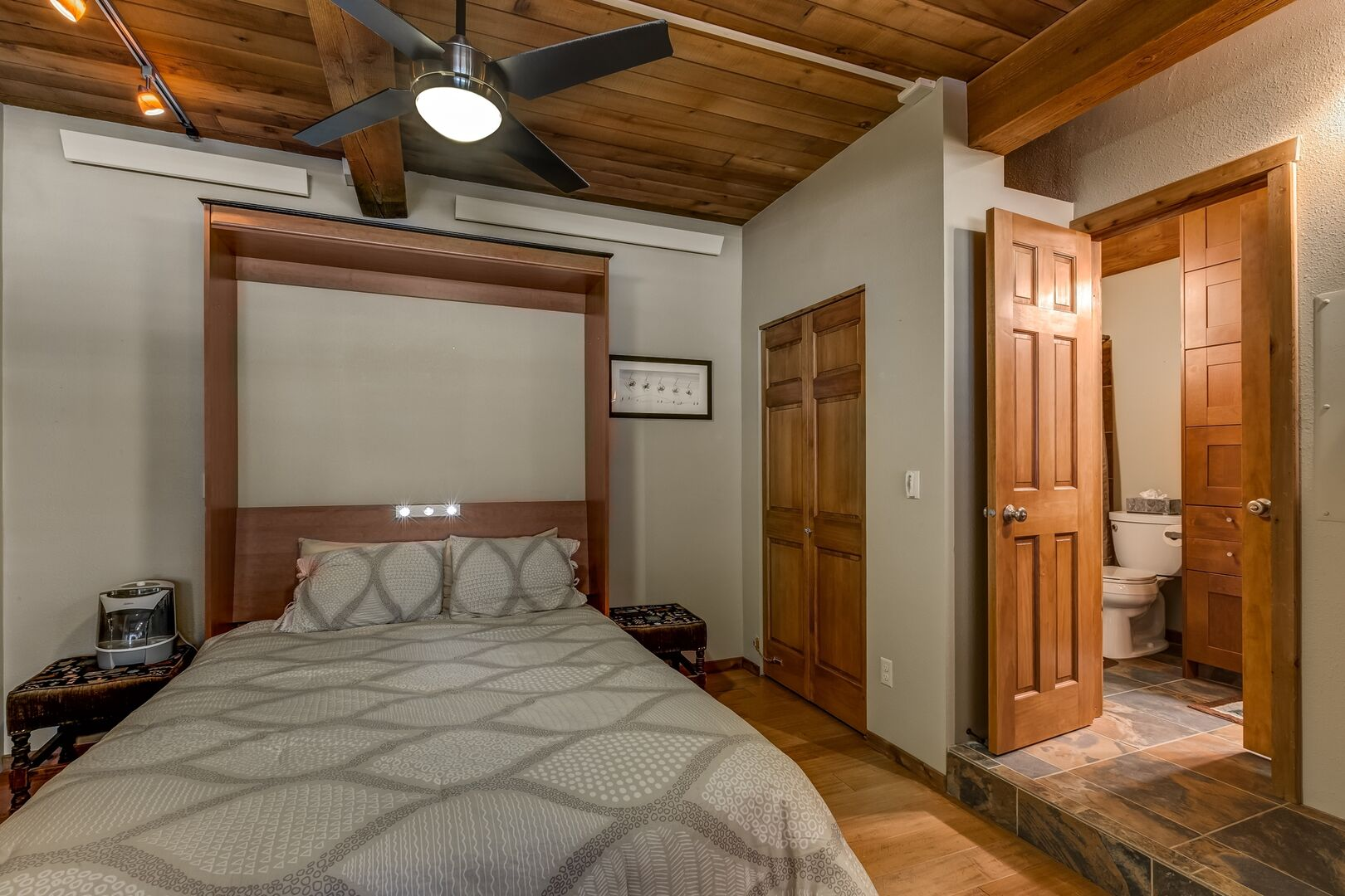 Murphy Bed  of a bedroom in this condo in Steamboat Springs  folds up into the wall.