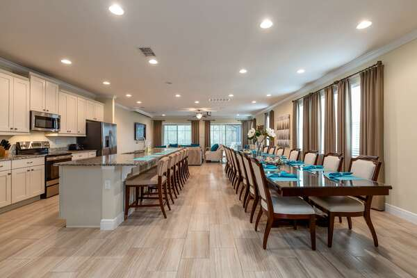 Everyone can dine together at the formal dining table with seating for 16