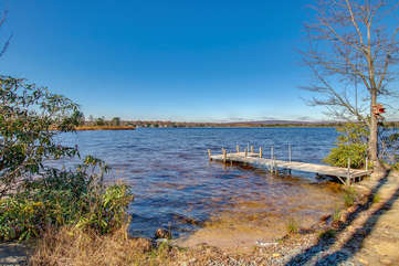 The lakefront access of this Poconos rental by the lake, complete with dock.