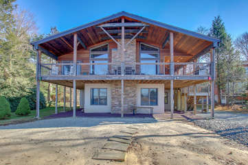The exterior of this Poconos rental by the Lake, displaying its elevated porch.