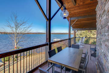 Another picture from the back porch, with porch furniture and a view over the lake.