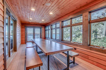 Dining room of this Poconos rental by the lake, with a large picnic style dining table.