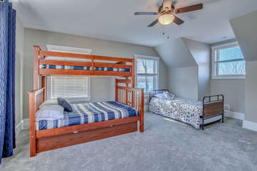 Bunk-bed in the side bedroom, next to twin bed.