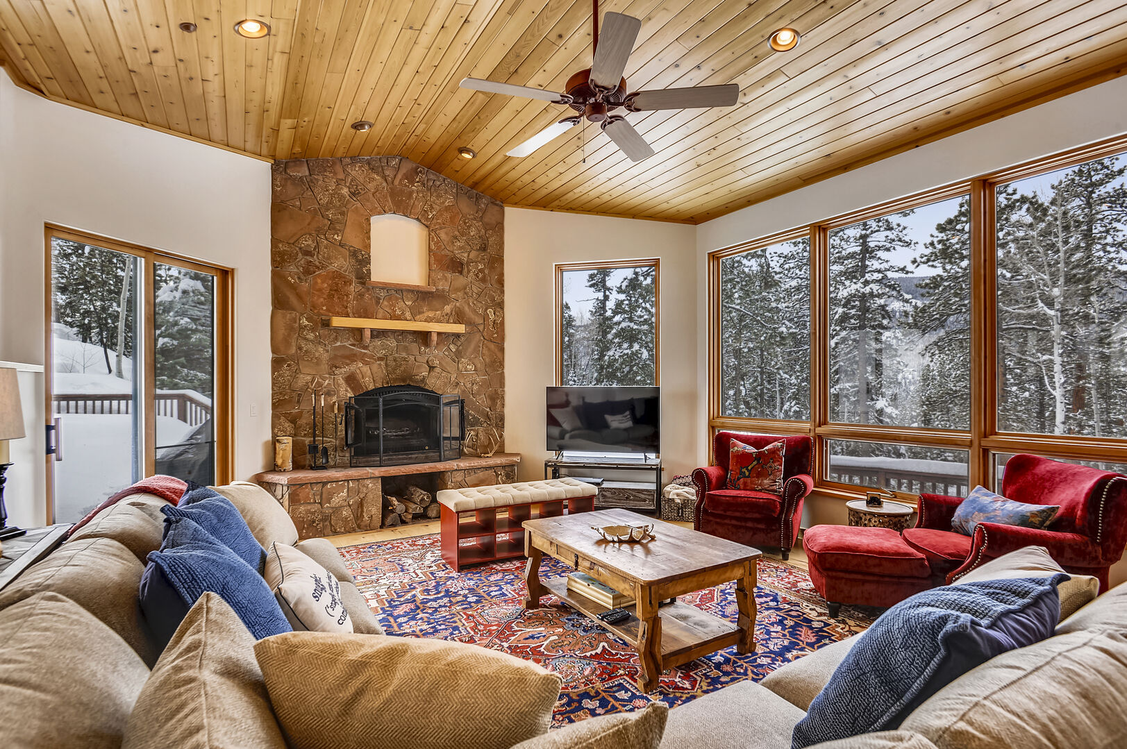 Wood burning fireplace to keep you cozy and a Large screen TV with plenty of seating