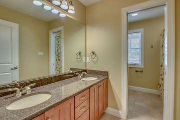 Double Sink Bathroom Vanity with Mirror and Shower.