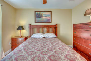 Large Bed with Nightstand, Lamps, and Dresser.