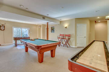Game Room with Pool Table, Foosball Table, and Two High Chairs.