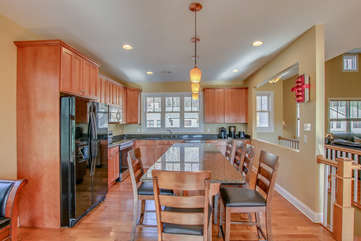Kitchen with Counter, High Chairs, and Refrigerator of our 6 Bedroom Poconos Rental.