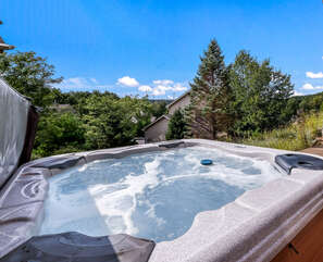 Outdoor Hot Tub with Forest View of our 6 Bedroom Poconos Rental