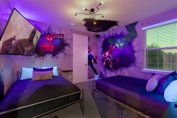 The room features custom artwork and a black light for cool effects