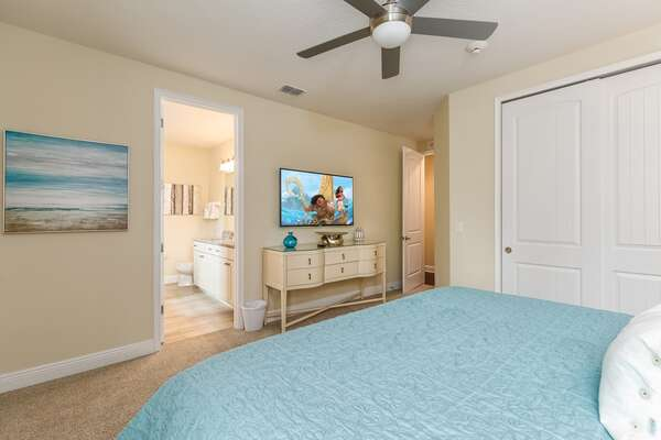 Enjoy the beach-themed bedroom, complete with a SMART TV