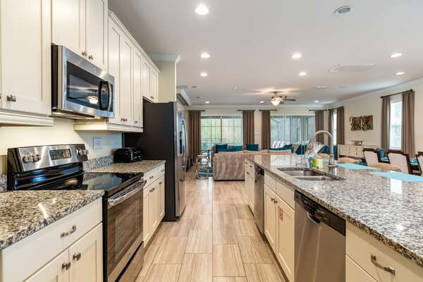 A fully-equipped gourmet kitchen is perfect for preparing delicious meals
