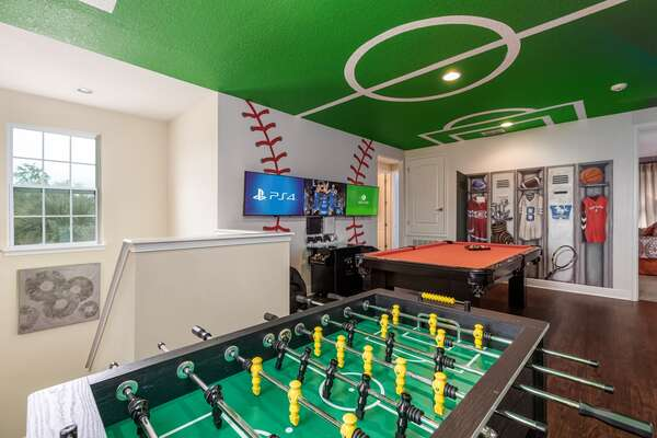 Head upstairs to the fun sports themed loft game room
