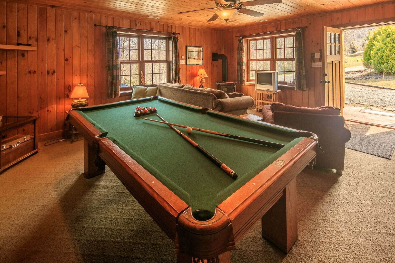 The lower level area with game table