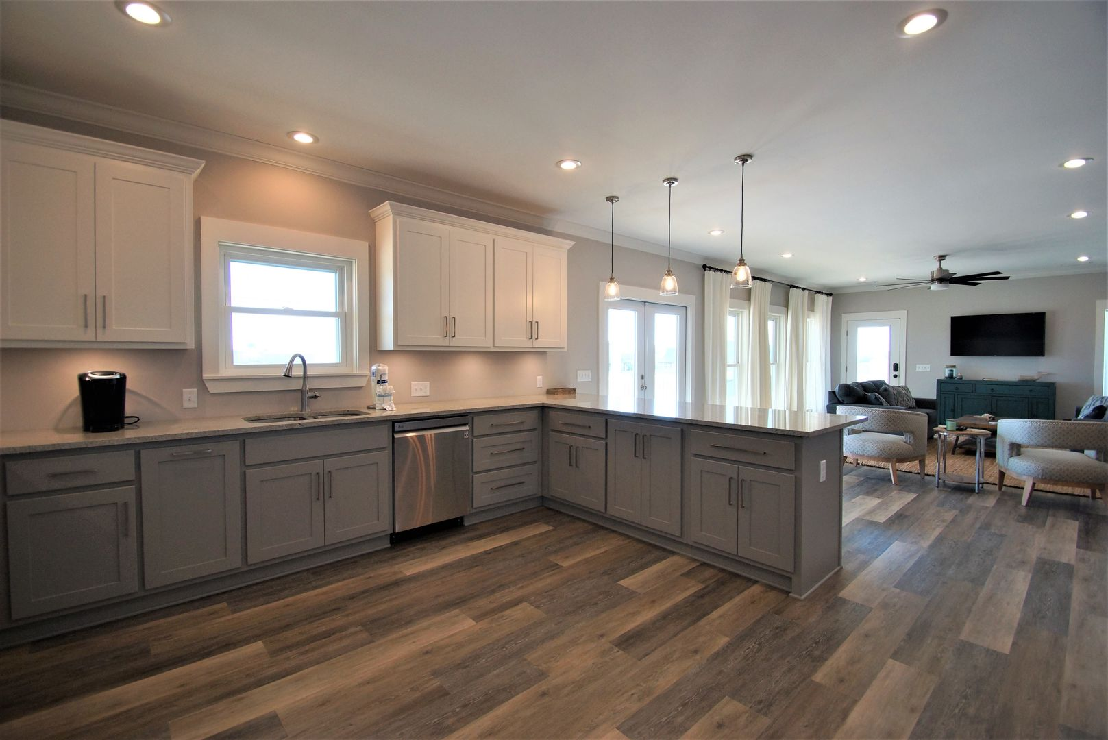 Prepare a meal in the large fully equipped kitchen, complete with modern appliances.