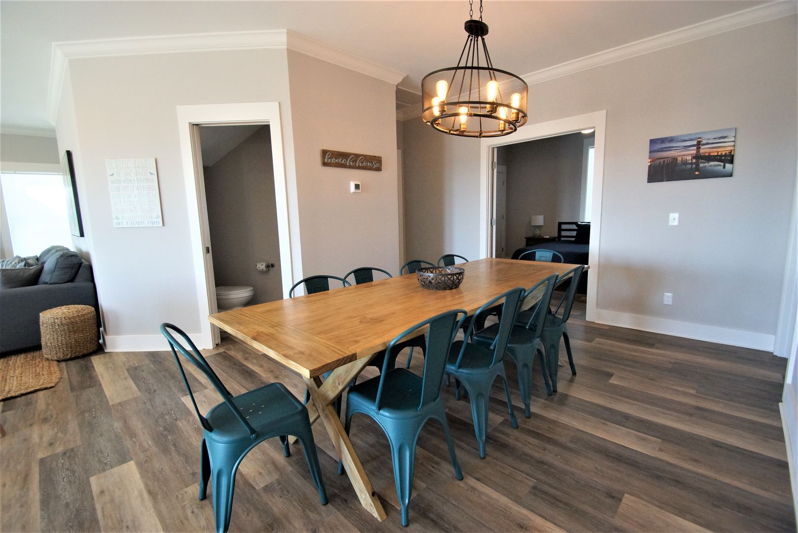 Beautiful dining area equipped to seat 10 with large table and chairs.