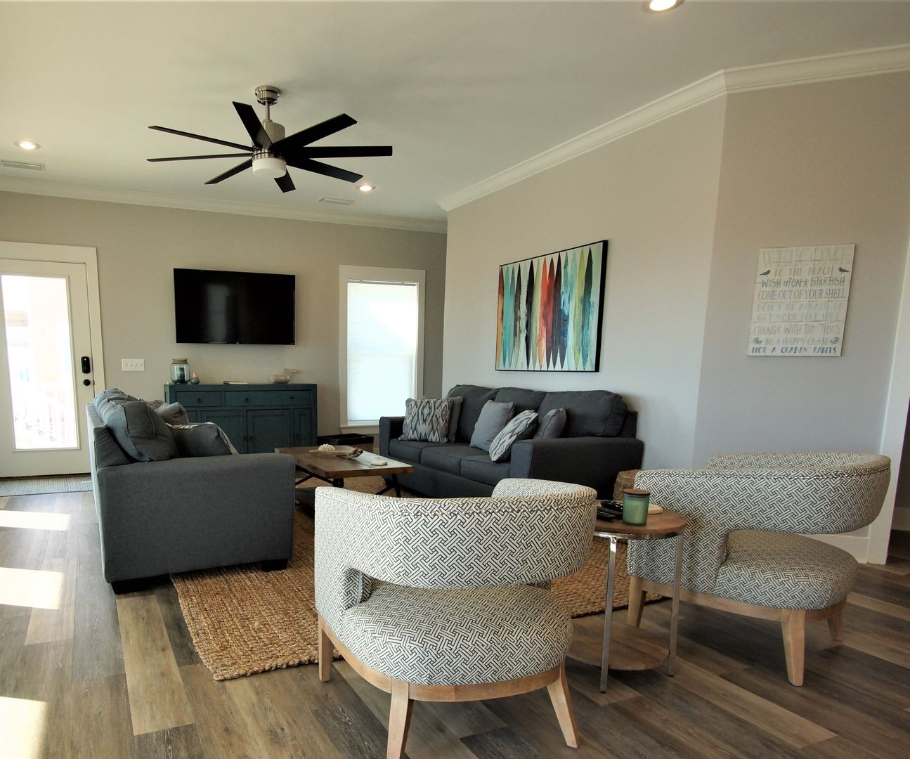 Spacious Living Area with plenty of seating and TV.