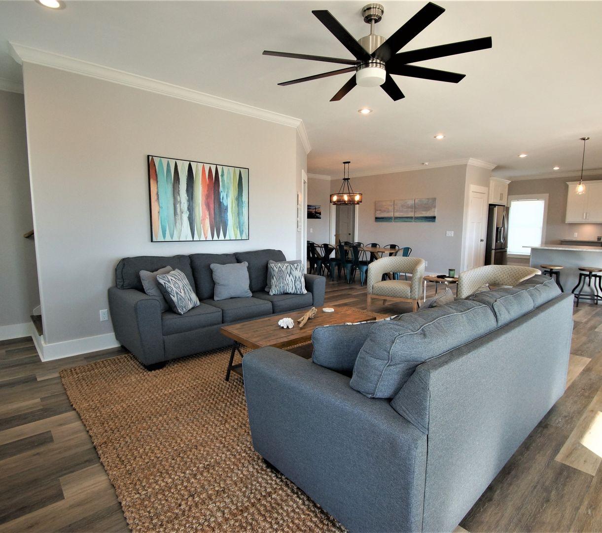 The living area has a sleeper sofa to sleep 2, TV, and coffee table.