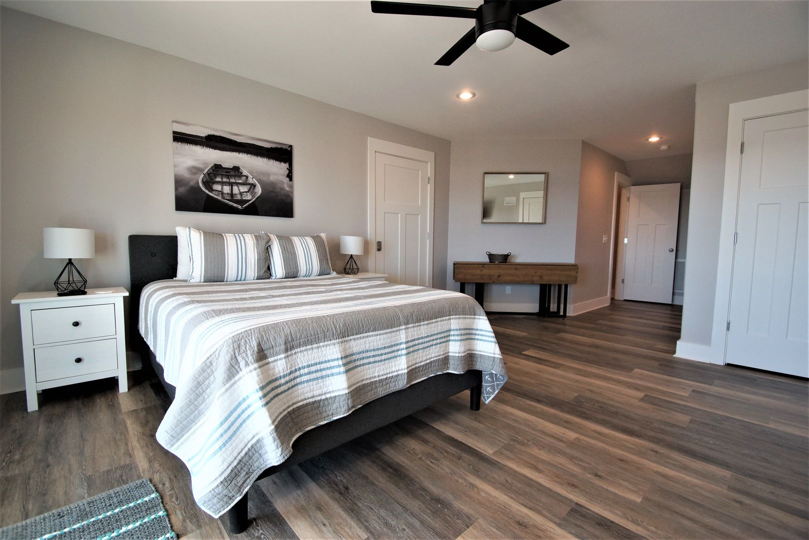 The spacious master has a queen bed to sleep 2 and twin nightstands.