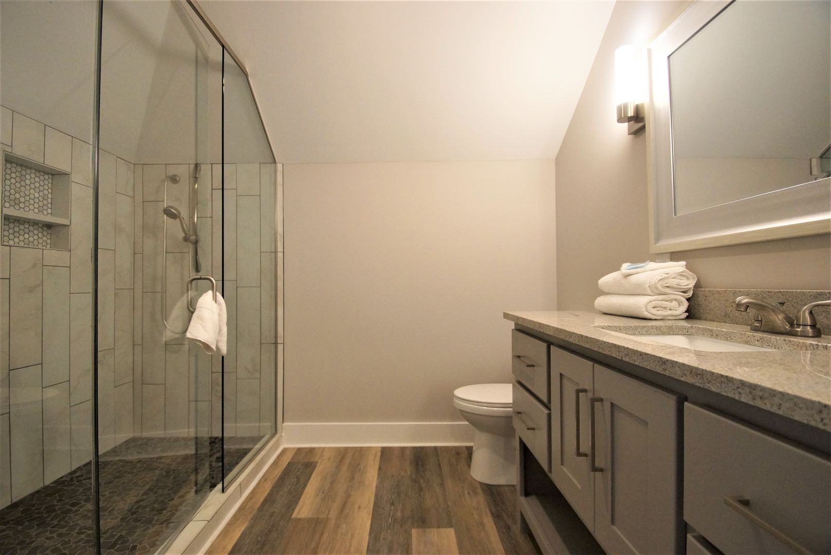 The master bath has a double shower.