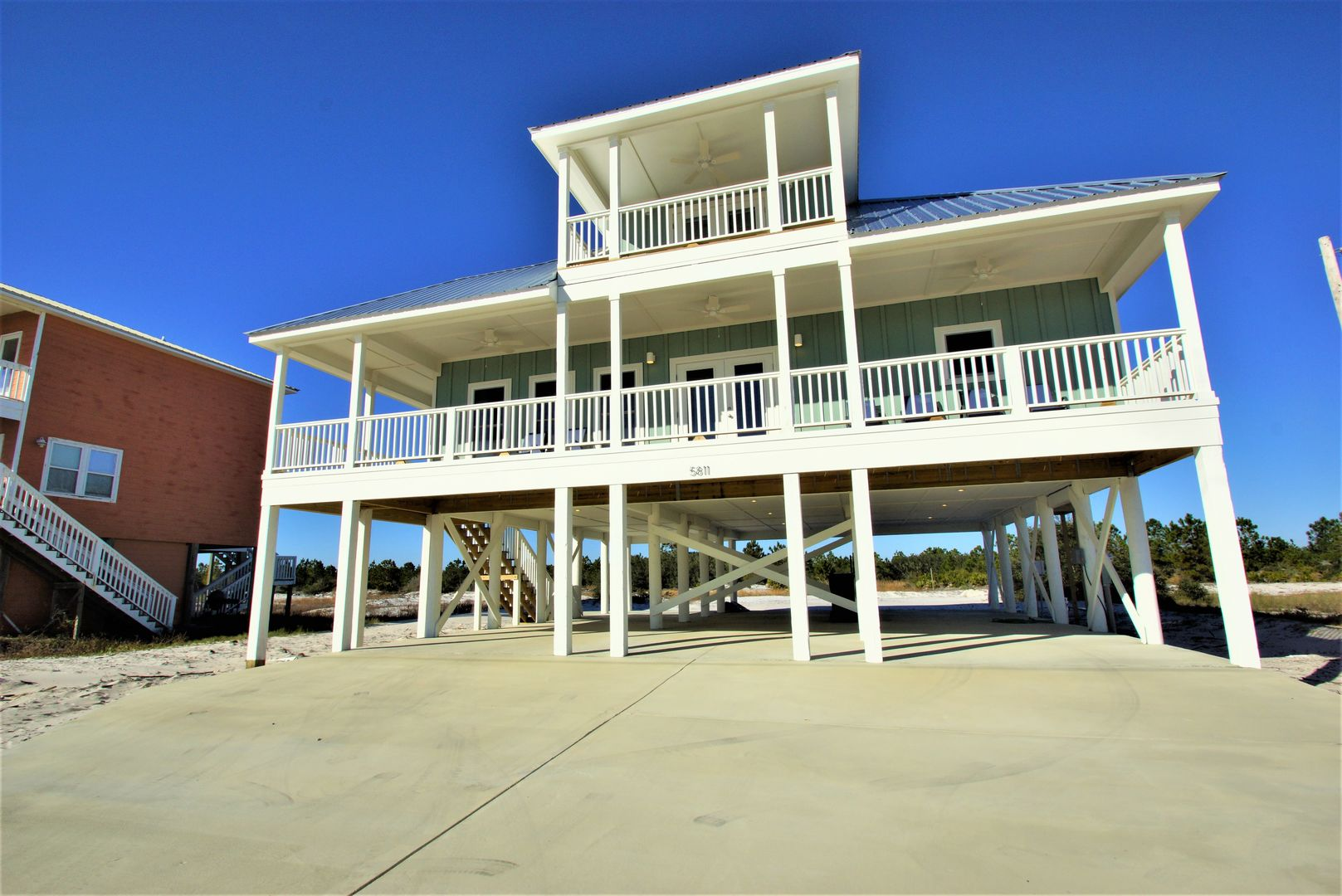 This Vacation Rental in Gulf Shores AL stands tall (picture of exterior)!