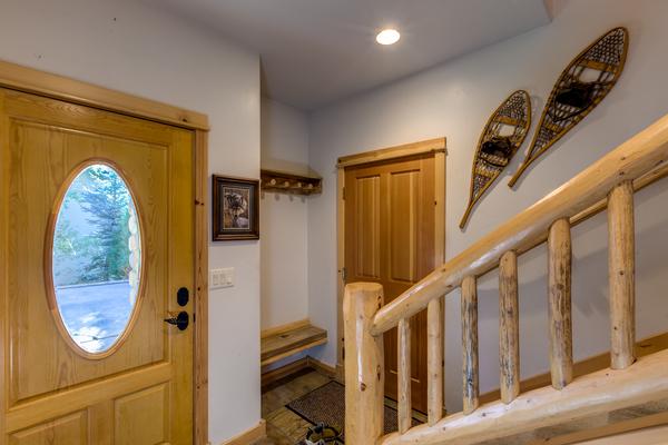 Front door, door to garage and steps to the main level