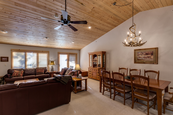 Beautiful high ceiling with couches and dining table