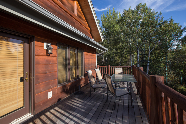 Deck with new gas grill at this steamboat springs vacation rental