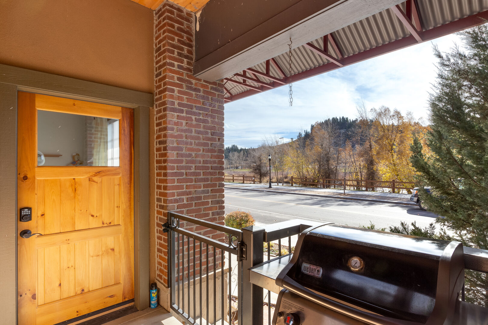 Door out to Yampa St. with grill at this pet friendly steamboat springs condo