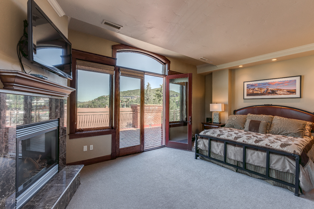 Master Bedroom with King Bed, Fireplace, and Patio Access