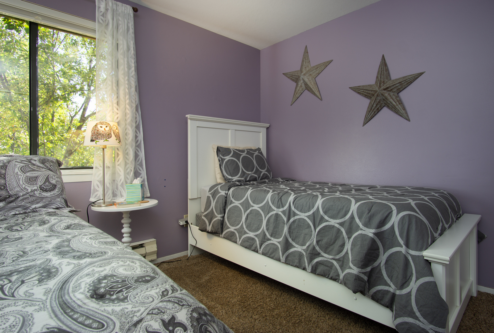 Cozy Purple and Gray Decor in Bedroom Two