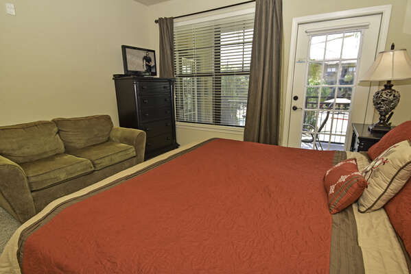 Master bedroom has a king size bed, flatscreen TV and balcony