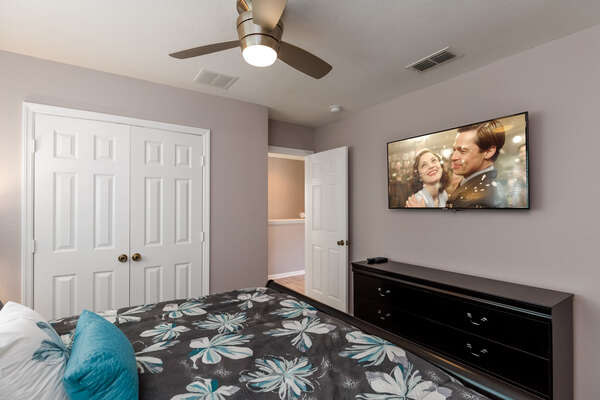 Watch TV and relax in this second floor bedroom