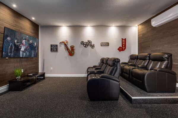 The movie theater room is perfect for watching movies on the 75-inch SMART TV