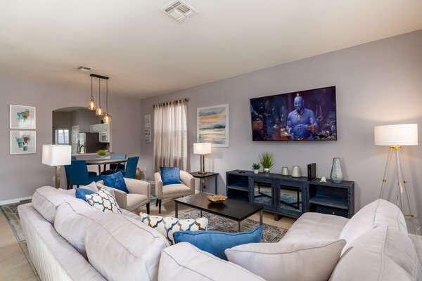 Relax on the plush couches and watch a favorite show on the TV