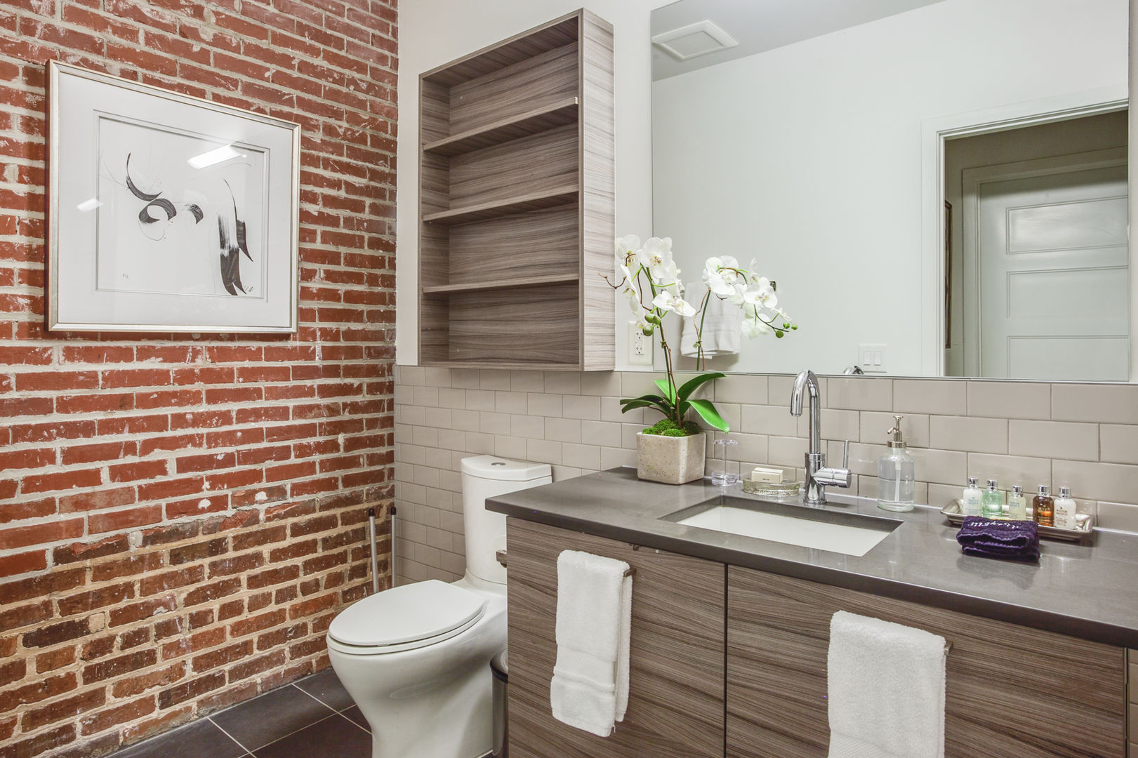 Bathroom with Brick Wall in our Ponce City Market Apartment