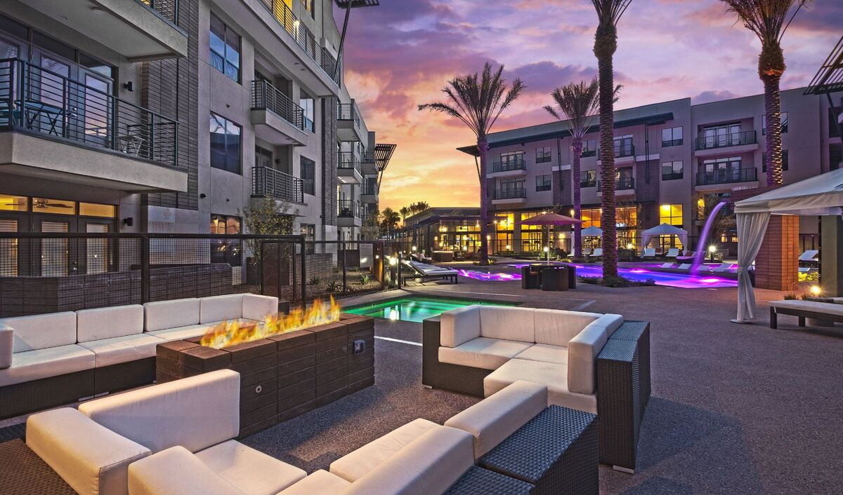 Community fire pit lounge next to the spa and resort-style heated pool w/ loungers and cabana's.
