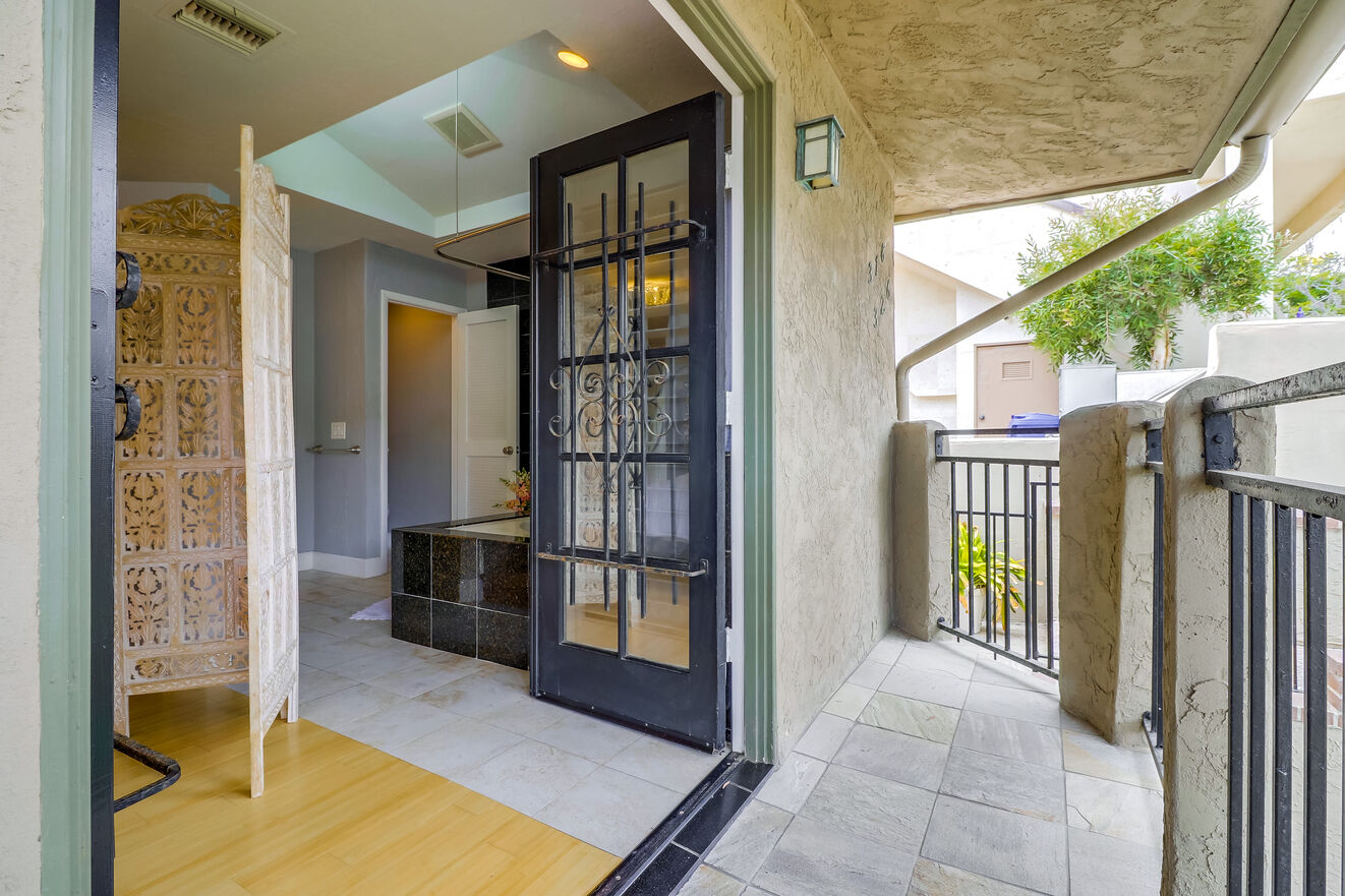Large doors open onto the patio outside the master suite