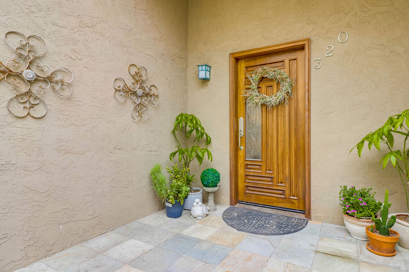 The property features a charming entryway for a great first impression