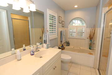 Master Bathroom with walk in shower and jetted tub