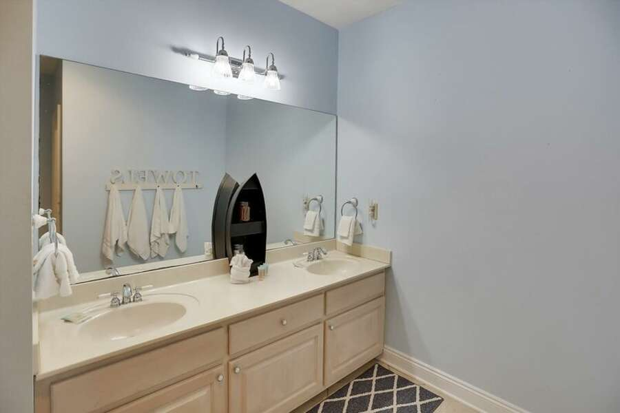 1st Floor Guest Bath has a Double Sink Vanity with a Shower/Tub Combo