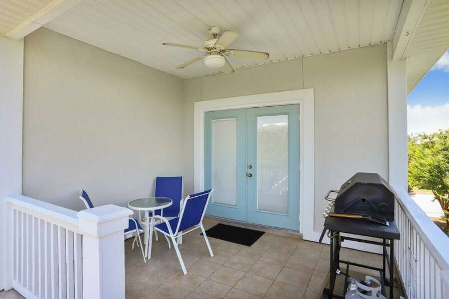 Back Porch with BBQ Grill and Outdoor Seating Area