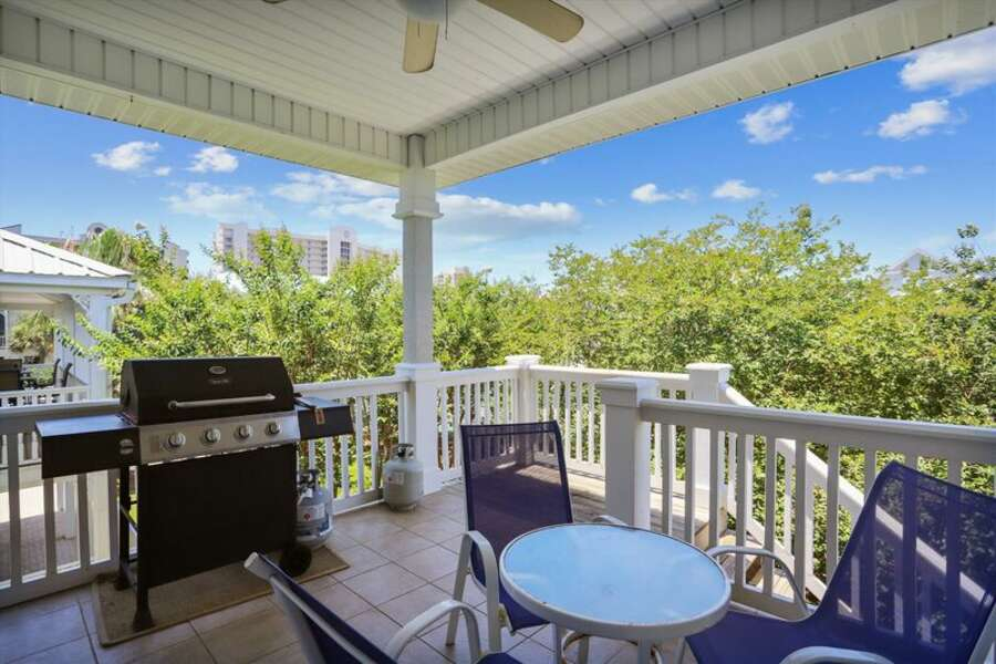 Back Porch overlooks the adjacent Pool and Tennis Courts