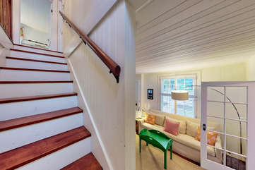 View from bottom of stairs to living space