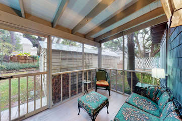 Screened in back porch overlooking yard