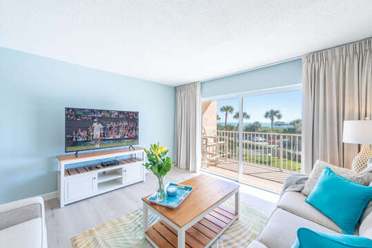 Big screen TV and a view of the ocean. Walk right out to the patio.