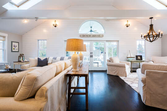 View of the main living area into the sun porch - 55 Lime Hill Chatham Cape Cod - New England Vacation Rentals