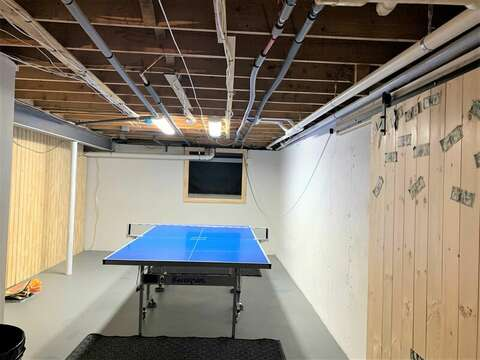 Ping pong table in lower level-55 Lime Hill Chatham Cape Cod - New England Vacation Rentals