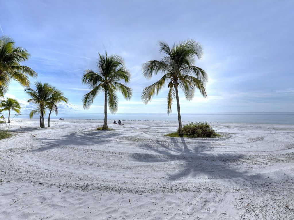 view of the beach with palm trees from our Fort Myers Beach cottage